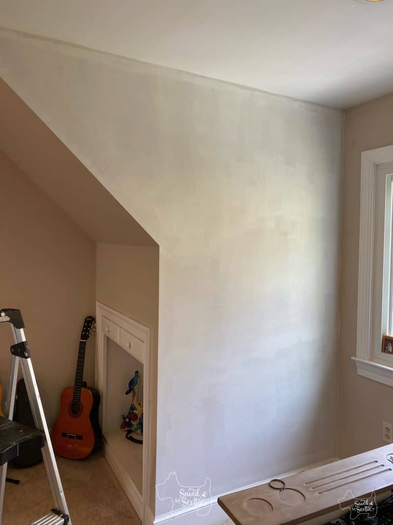 wall in bedroom with a coat of primer on it.