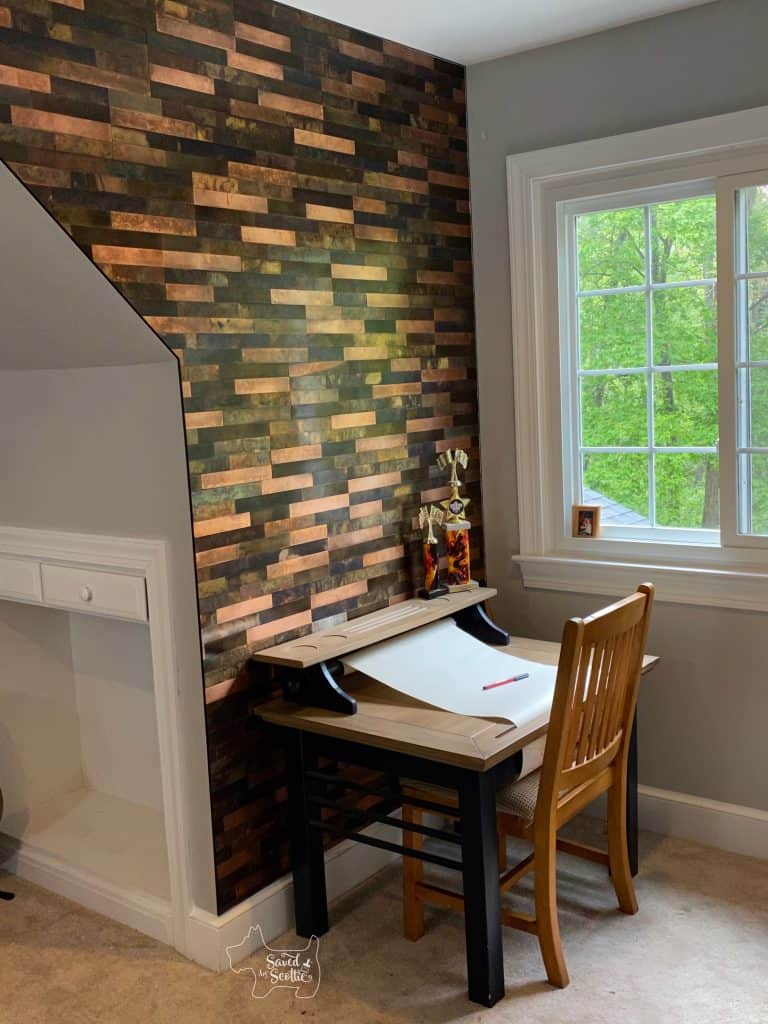 metal tile wall with desk in place