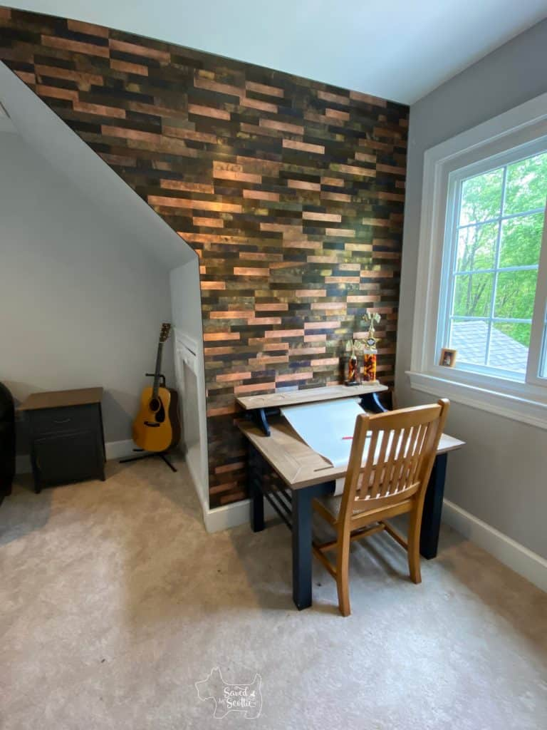 full view of metal tile wall with desk in place