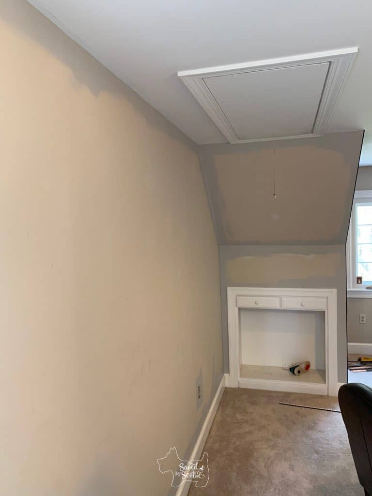 wall of room near the accent wall with the new paint on the edges