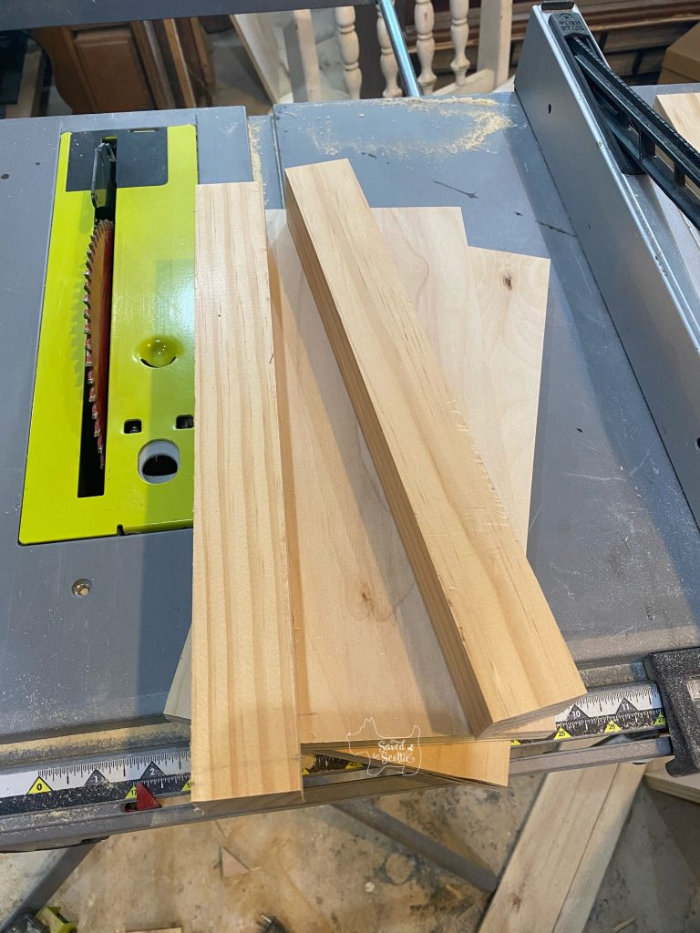 support pieces to build a narrow sofa table laying on a ryobi table saw in a workshop setting