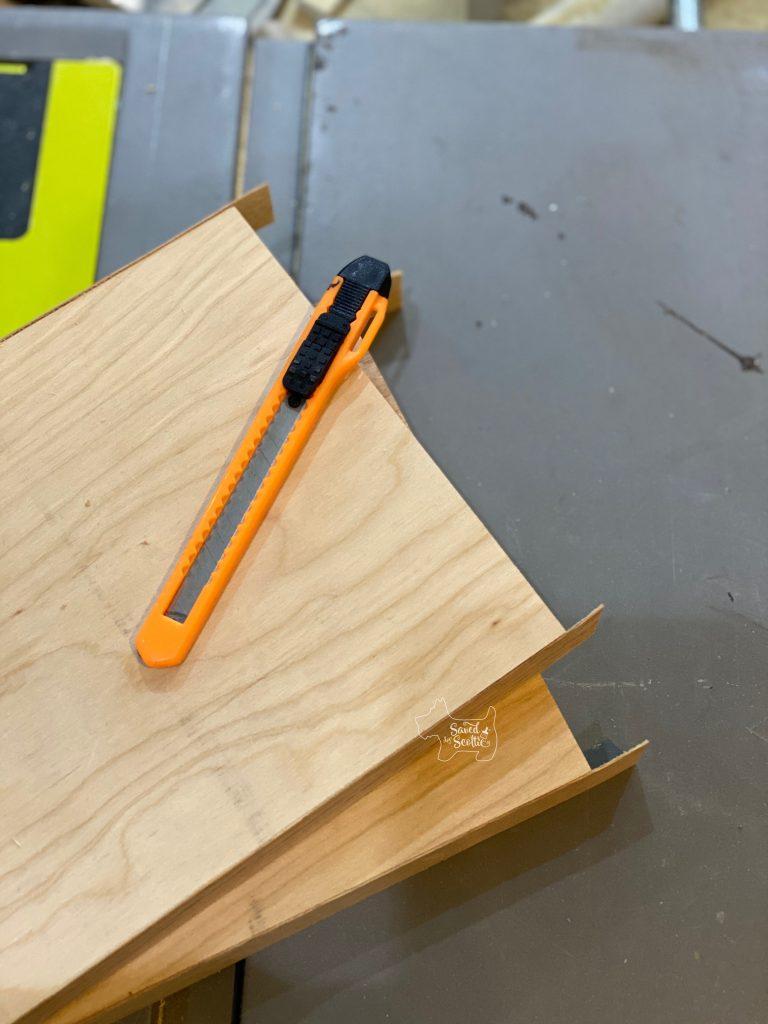 boards with veneer edging overhang and razor knife