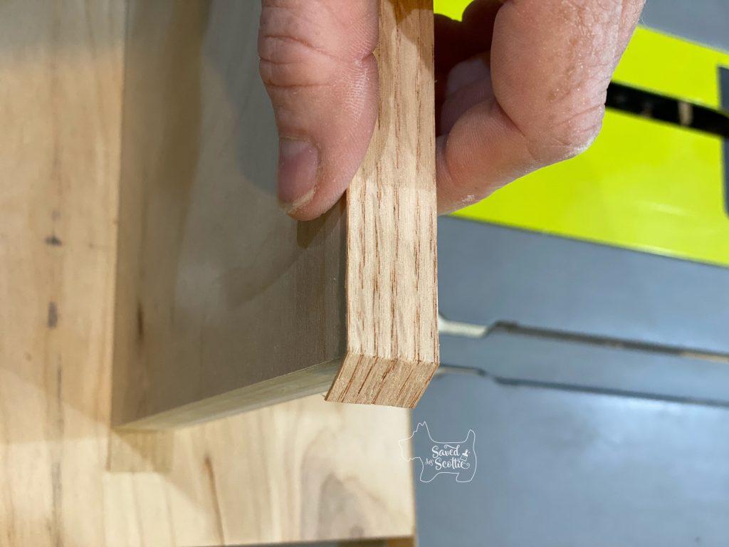 process of trimming end of veneer edging