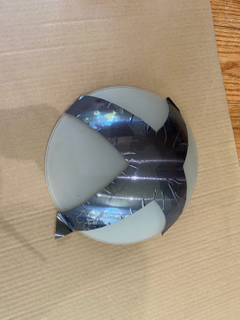 lamp cover orb with vinyl cut out applied. Surface is wrinkled on the edges.