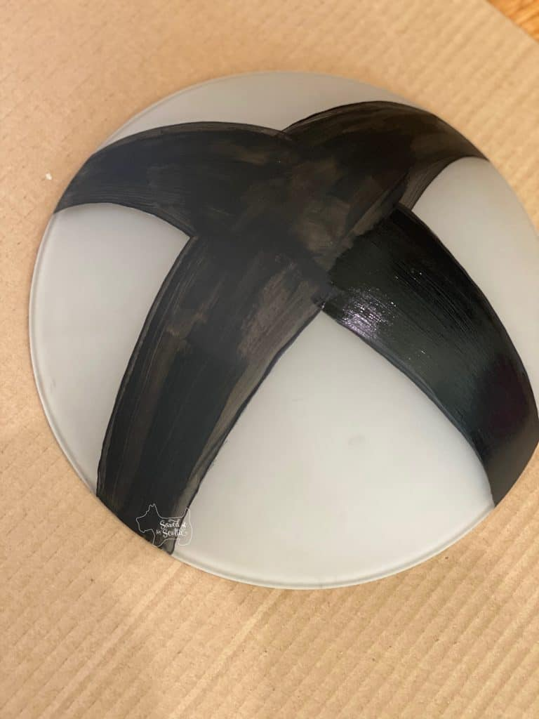 "xbox lamp cover orb with one coat of black paint and second coat applied to one leg of ""X"""
