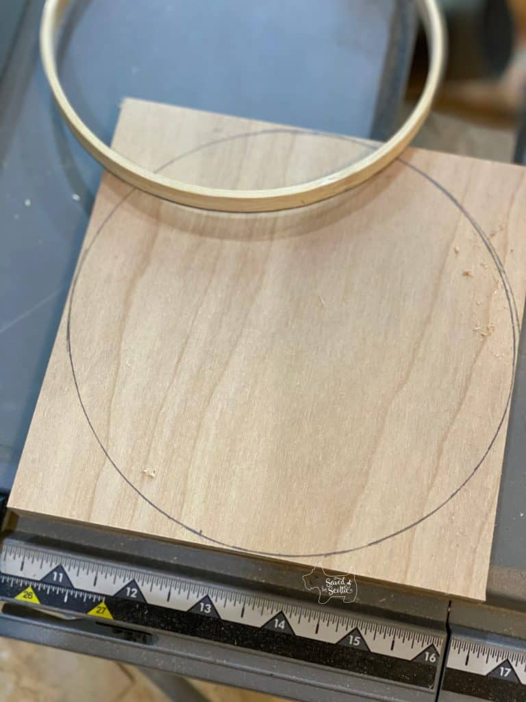 wood plywood base with circle drawn in pencil and hoop used for template