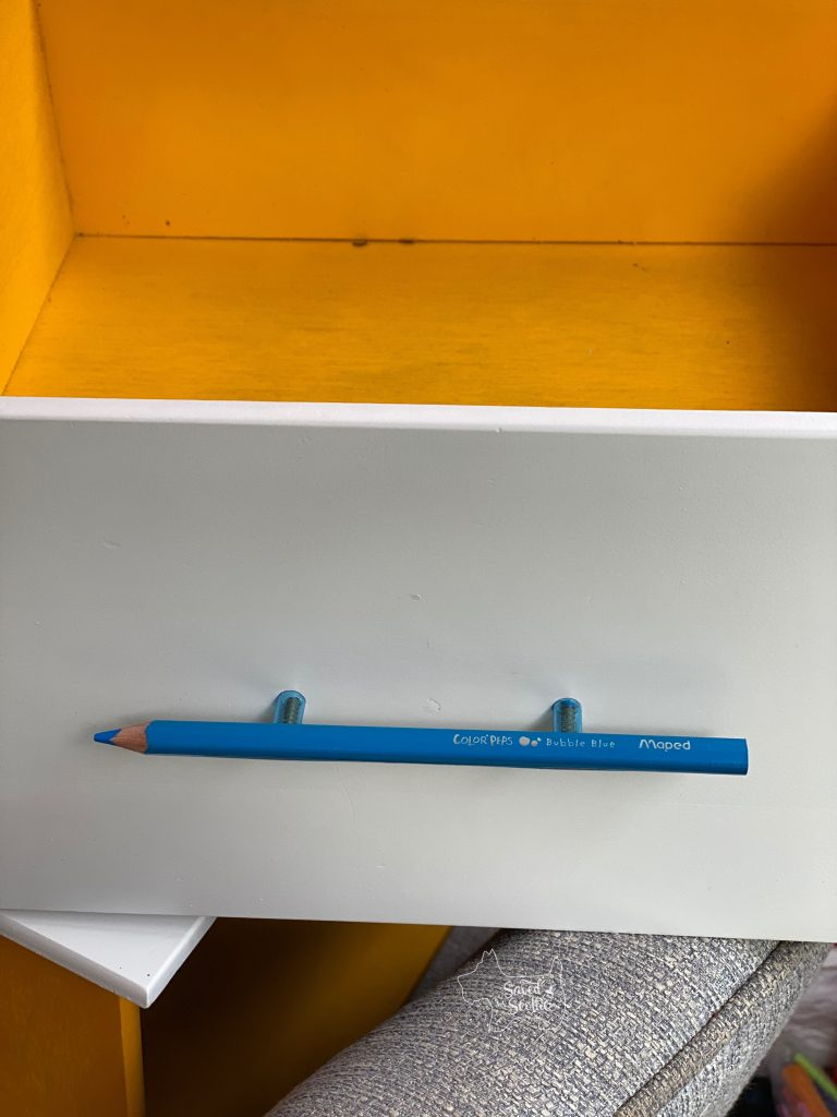 new colored pencil unique drawer pull attached to drawer front