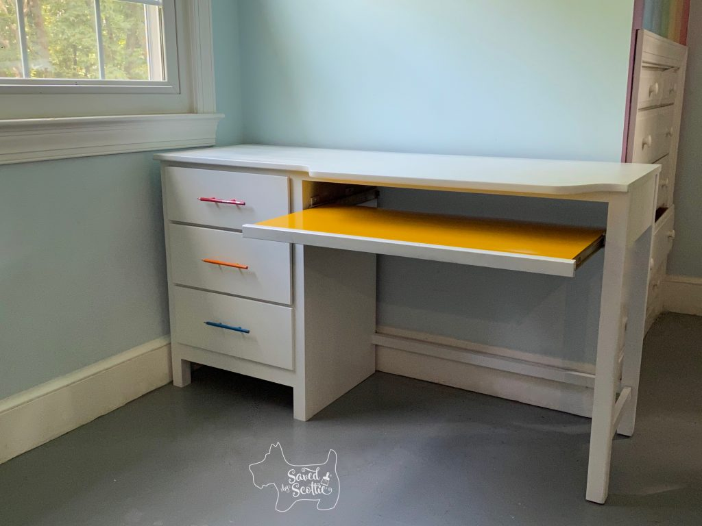 full view of desk showing colored pencil unique drawer pulls