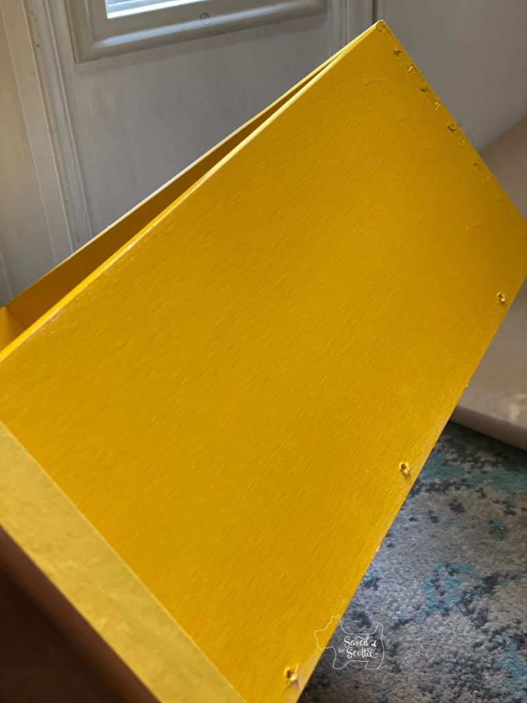 desk drawer side painted in bright yellow