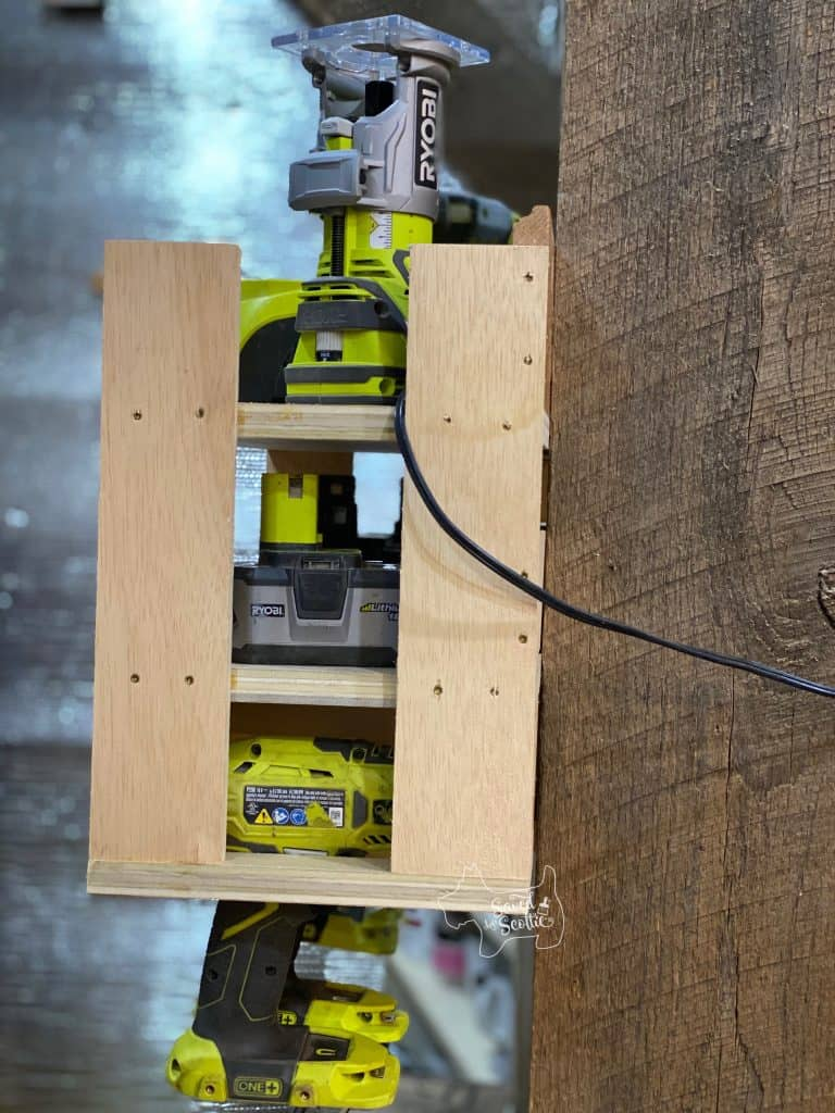 side view of tool charging station in workshop setting loaded up with Ryobi cordless tools.