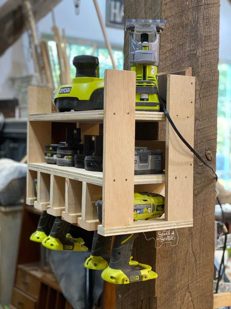 tool charging station hanging on thick post in workshop setting loaded up with ryobi cordless tools